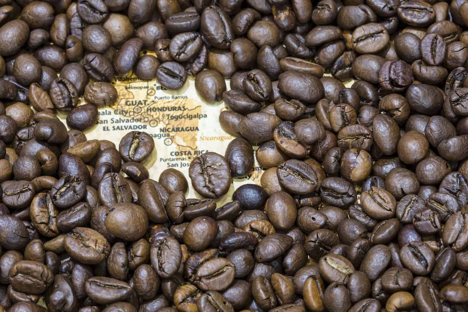 Map of Central America under a background of coffee beans