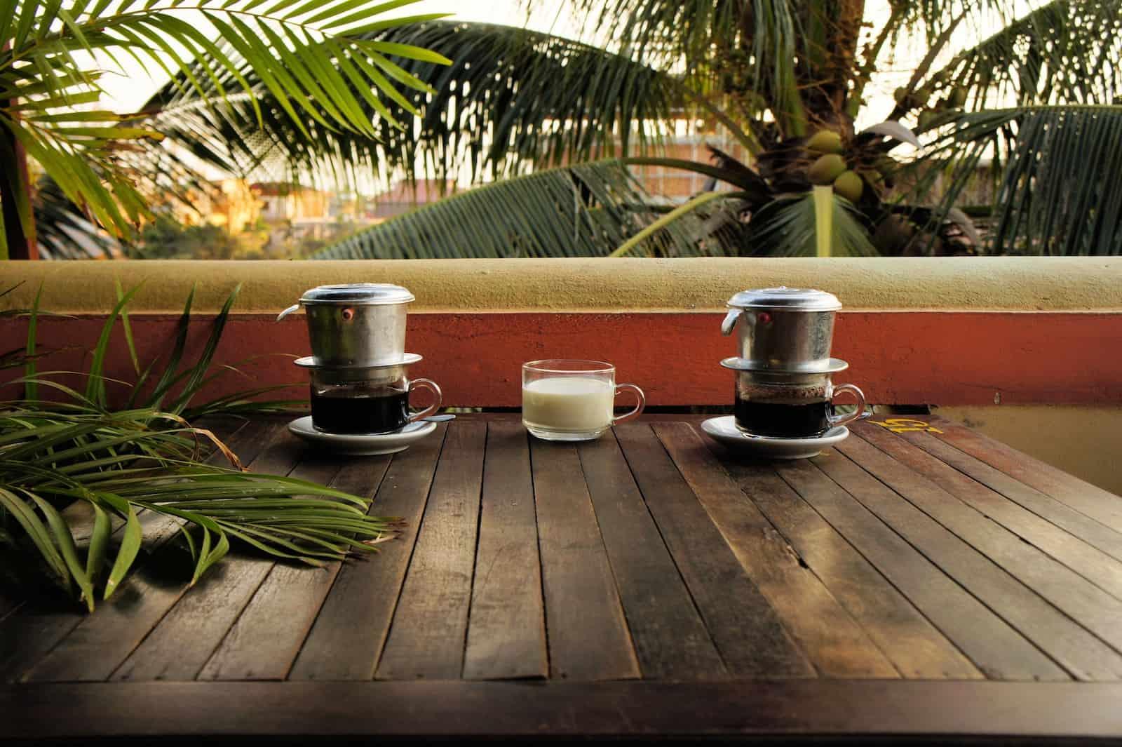 Vietnam Dripping Coffee with milk under palm trees