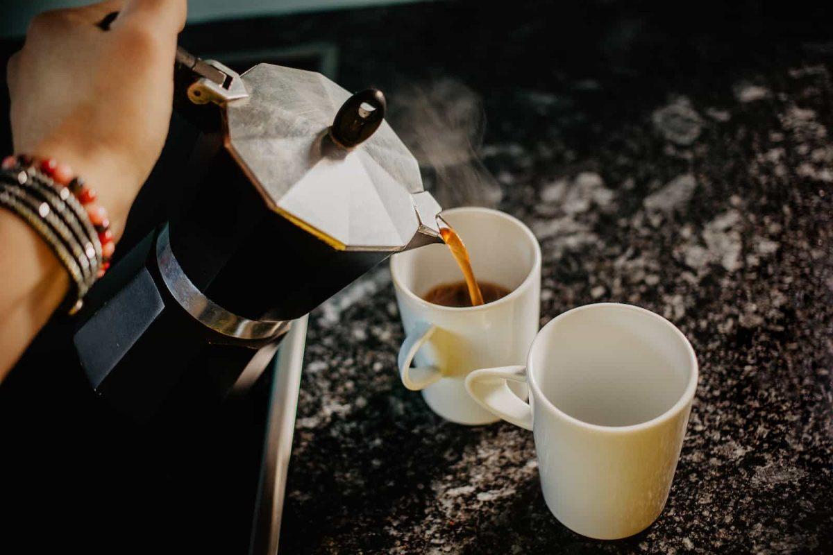 Preparing fresh coffee in moka pot